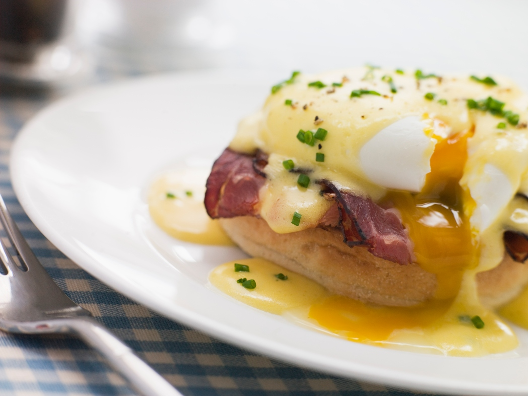 Brunch - poached eggs and bacon topped on an english muffin